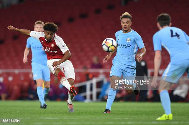 Reiss Nelson of Arsenal shoots under pressure from Joel Latibeaudiere of Man City during the match between Arsenal U23 and Manchester City U23 at...