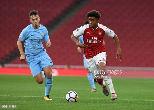 Reiss Nelson of Arsenal takes on Charlie Oliver of Man City during the match between Arsenal U23 and Manchester City U23 at Emirates Stadium on...