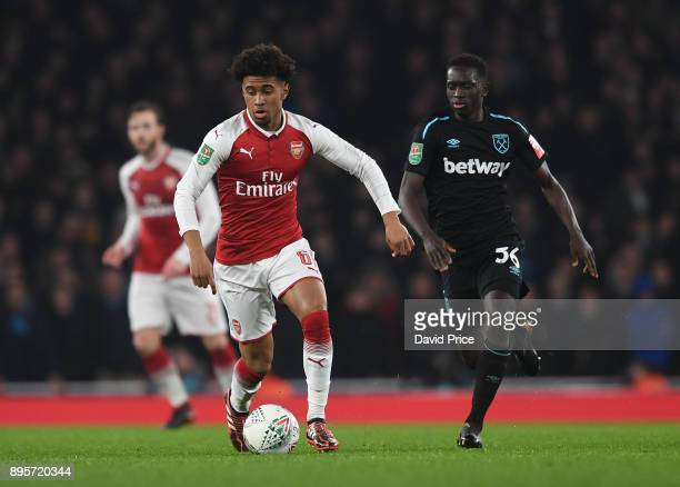 Reiss Nelson of Arsenal takes on Domingos Quina of West Ham during the Carabao Cup Quarter Final match between Arsenal and West Ham United at...