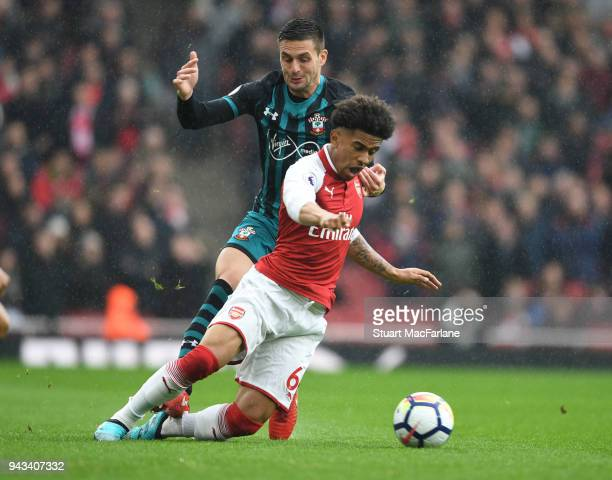 Reiss Nelson of Arsenal takes on Dusan Tadic of Southampton during the Premier League match between Arsenal and Southampton at Emirates Stadium on...