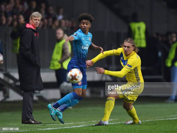 Reiss Nelson of Arsenal takes on Makism Gordeichuk of BATE during the UEFA Europa League group H match between BATE Borisov and Arsenal FC at...