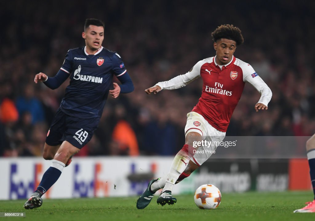 Reiss Nelson of Arsenal takes on Nemanja Radonjic of Red Star during the UEFA Europa League group H match between Arsenal FC and Crvena Zvezda at Emirates Stadium on November 2, 2017 in London, United Kingdom.