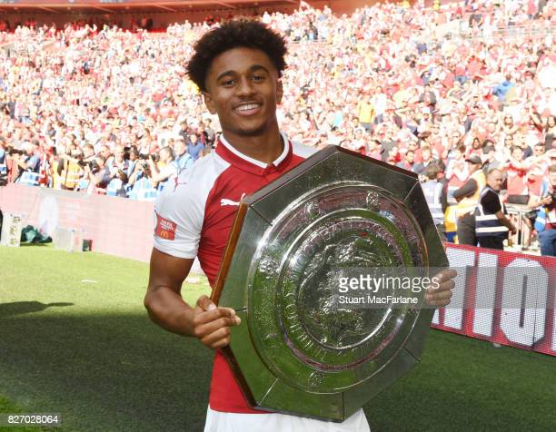 Reiss Nelson of Arsenal with the Community shield after the FA Community Shield match between Chelsea and Arsenal at Wembley Stadium on August 6 2017...