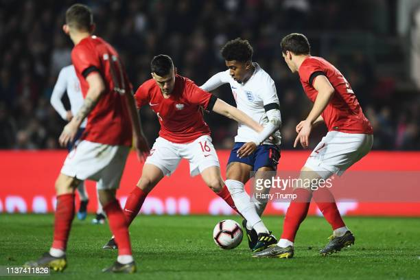 Reiss Nelson of England gets past the tackle from Krystian Bielik and Patryk Dziczek of Poland during the U21 International Friendly match between...