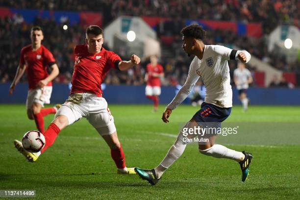 Reiss Nelson of England shoots on goal in front of Karol Fila of Poland during the U21 International Friendly match between England and Poland at...