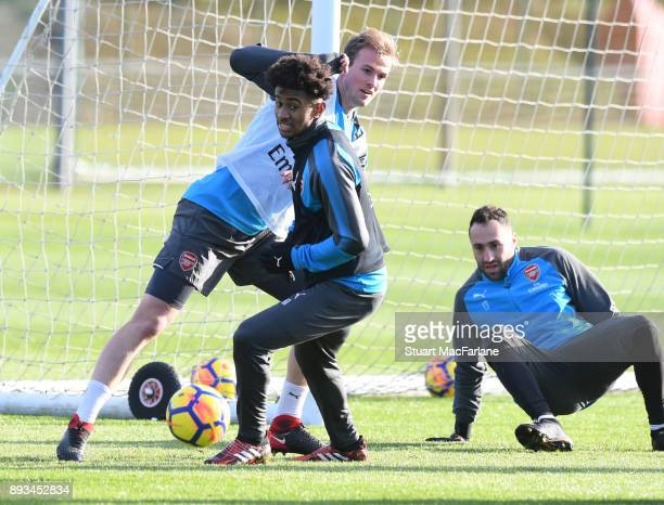 Reiss Nelson Rob Holding and David Ospina of Arsenal during a training session at London Colney on December 15 2017 in St Albans England