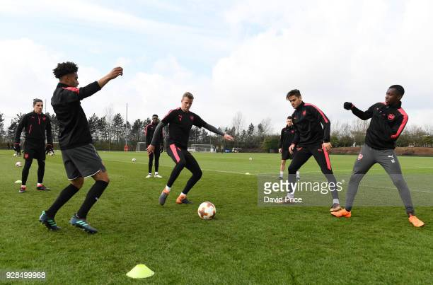 Reiss Nelson Rob Holding Konsatinos Mavropanos and Eddie Nketiah of Arsenal during the Arsenal Training Session at London Colney on March 7 2018 in...