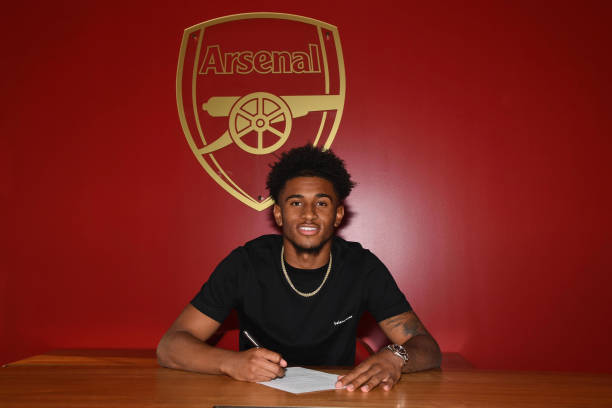 Reiss Nelson signs a new long-term contract at Arsenal at London Colney on August 31, 2018 in St Albans, England.