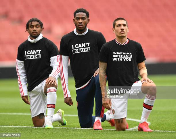 Reiss Nelson Zech Medley and Hector Bellerin of Arsenal take a knee in support of Black Lives Matter before the friendly match between Arsenal and...
