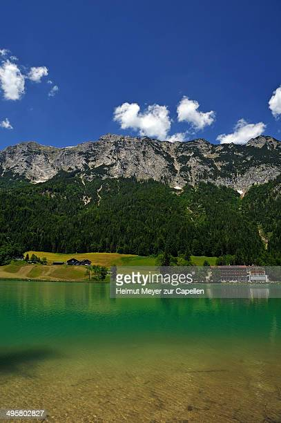 reiter alps, the shimmering green lake hintersee at the front, ramsau bei berchtesgaden, berchtesgadener land district, upper bavaria, bavaria, germany - berchtesgaden alps stock photos and pictures
