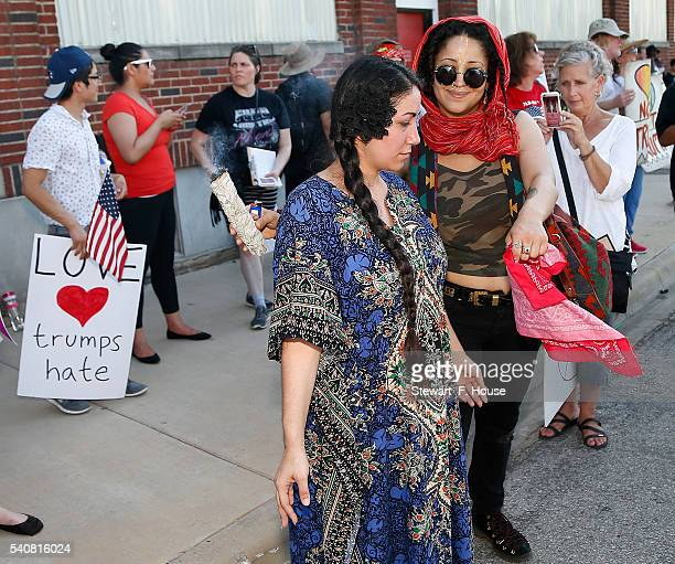 Reivin Alexandria of Dallas Texas uses burning sage to cleanse Alexis Estrada of Arlington Texas during a protest outside a rally for Republican...