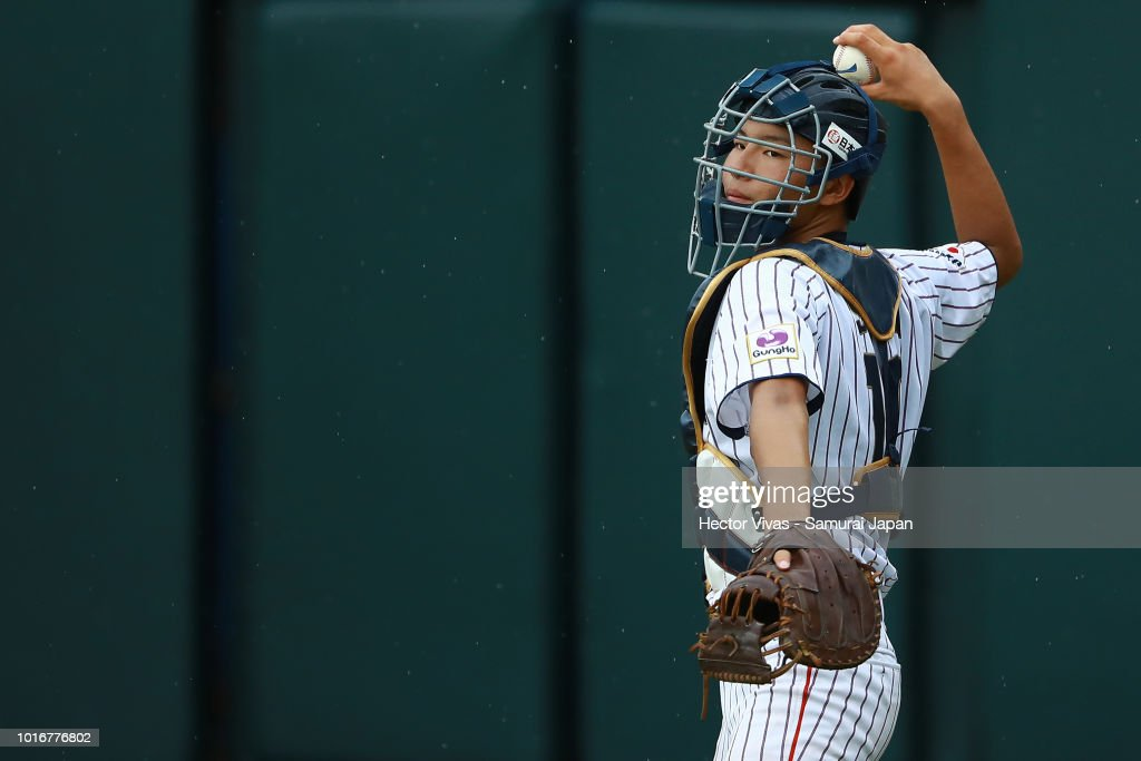 Reiya Saka #10 of Japan throws the ball during the WBSC U-15 World Cup Group B match between Australia and Japan at Estadio Rico Cedeno on August 10, 2018 in Chitre, Panama.