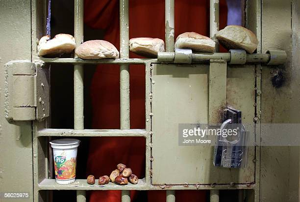 Rejected by an Iraqi prisoner bread and dates await removal from the door of a solitary confinement cell in the Iraqigovernmentrun criminal section...