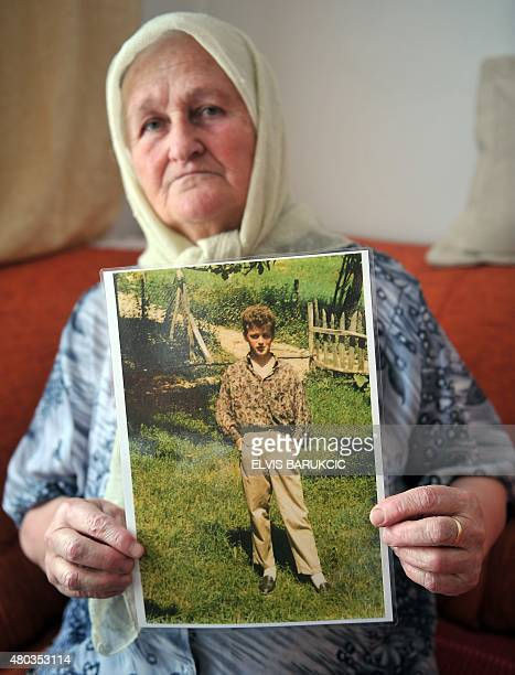 Rejha Ademovic, a Bosnian Muslim woman, survivor of the 1995 Srebrenica massacre, shows a picture of her son in her home in Sarajevo, on July 5,...