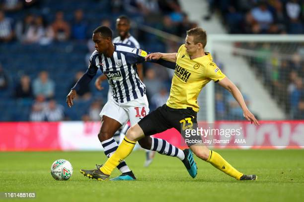 Rekeem Harper of West Bromwich Albion and Jon Dadi Bodvarsson of Millwall during the Carabao Cup First Round match between West Bromwich Albion and...