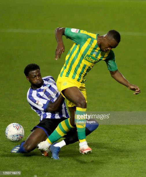Rekeem Harper of West Bromwich Albion is challenged by Dominic Iorfa of Sheffield Wednesday during the Sky Bet Championship match between Sheffield...