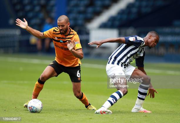 Rekeem Harper of West Bromwich Albion is challenged by Kevin Stewart during the Sky Bet Championship match between West Bromwich Albion and Hull City...