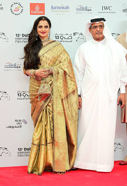 Rekha and DIFF Chairman Abdulhamid Juma attend the Opening Night Gala during day one of the 13th annual Dubai International Film Festival held at the.