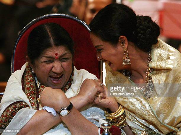 Rekha and lata mangeshkar shaing a lighter moment on Lata mangeshkars birthday at Samukhananda hall