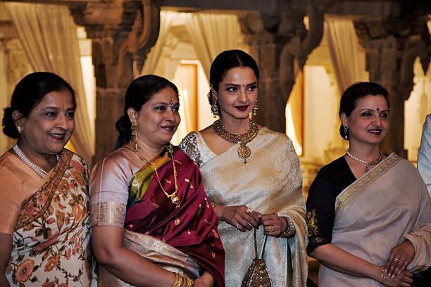 Rekha, Bollywood actress, Rekha with guests at Holi festival. Udaipur, India.