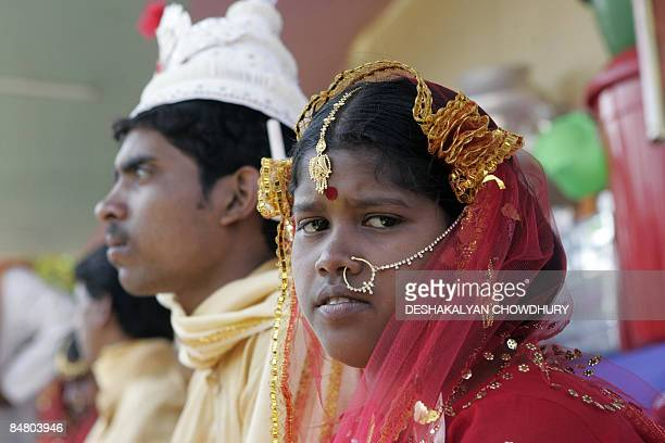 Rekha Khetrapla and her groom Ganesh Sardar wait to consummate their marriage during a mass wedding ceremony in Bahirkhand some 60 kms north of...