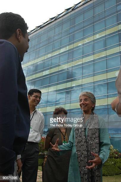 Rekha Menon, Chola Freedom Technology Accenture with her employees in Bangalore, Karnataka, India