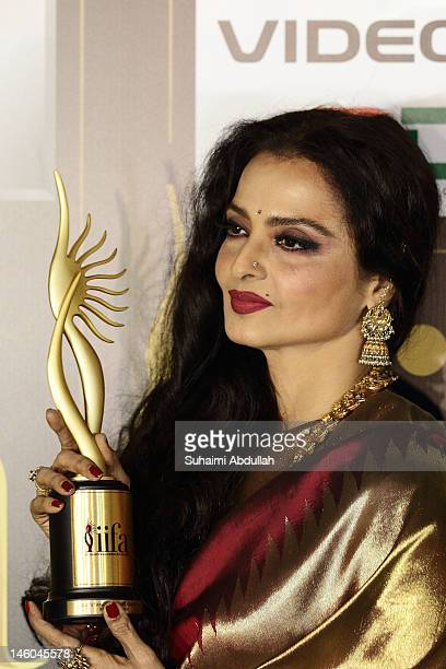 Rekha poses for a photo after she wins the Lifetime Achievement award at the 2012 International India Film Academy Awards at the Singapore Indoor...