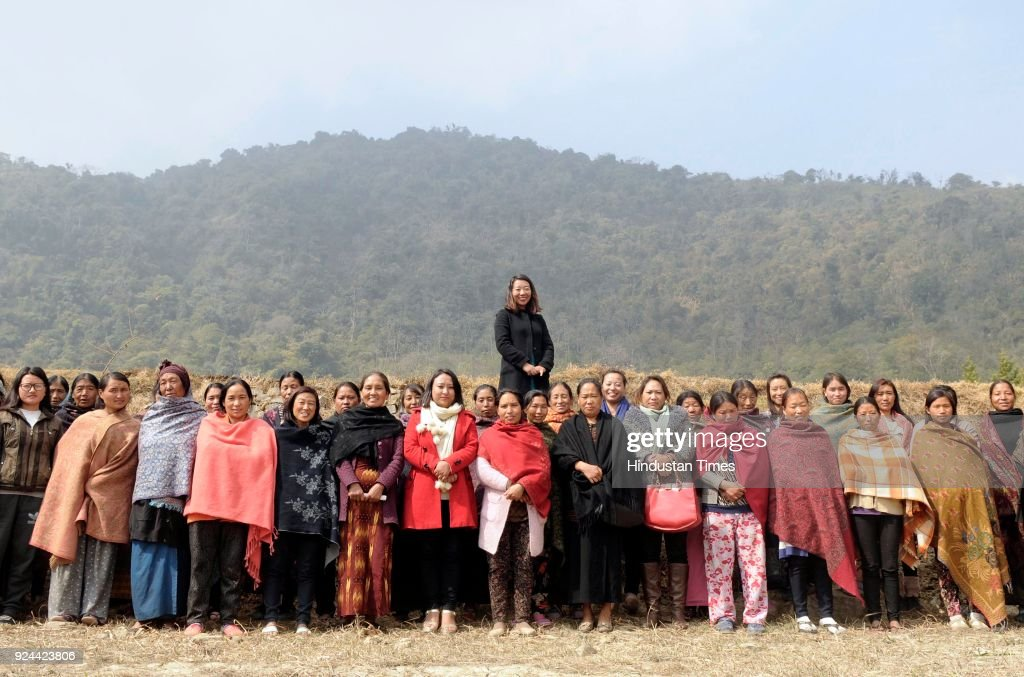 Rekha Rose Dukru an independent candidate from the Chizami seat with a group of women from Tsupfume village during election campaign for Nagaland...