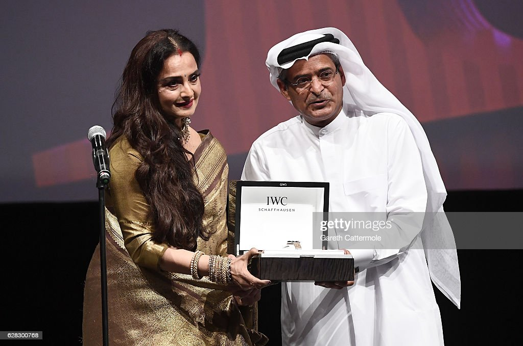 Rekha who received the Lifetime Achievement award and DIFF Chairman Abdulhamid Juma on stage at the Opening Night Gala during day one of the 13th...