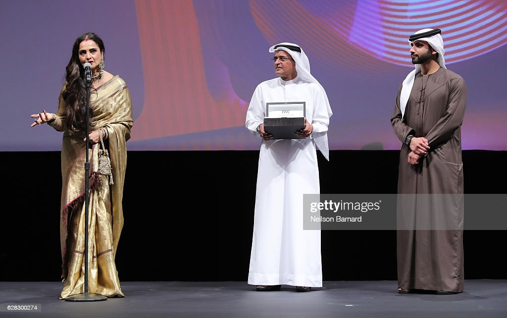 Rekha who received the Lifetime Achievement award DIFF Chairman Abdulhamid Juma and Sheikh Mansoor bin Mohammed bin Rashid Al Maktoum on stage at the.