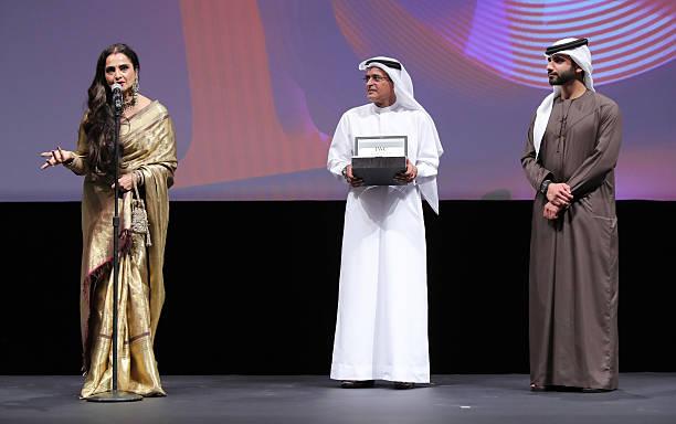 Rekha who received the Lifetime Achievement award DIFF Chairman Abdulhamid Juma and Sheikh Mansoor bin Mohammed bin Rashid Al Maktoum on stage at the.