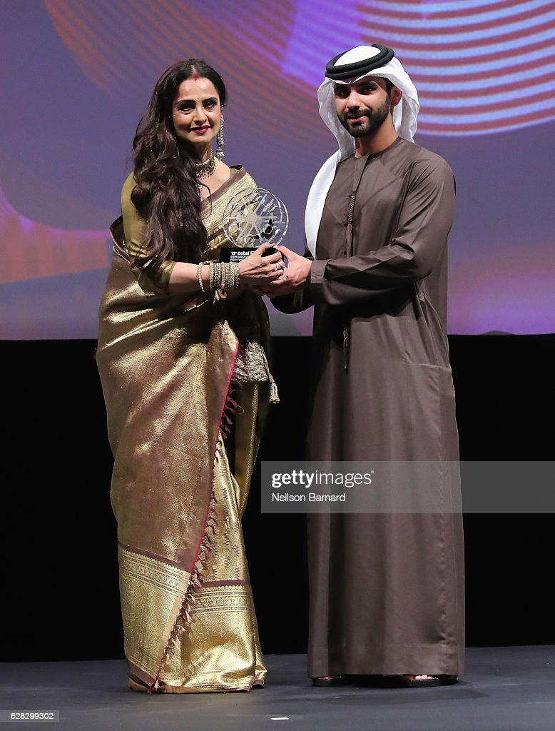 Rekha who received the Lifetime Achievement award from Sheikh Mansoor bin Mohammed bin Rashid Al Maktoum on stage at the Opening Night Gala during...