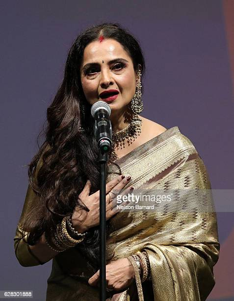 Rekha who received the Lifetime Achievement award speaks on stage at the Opening Night Gala during day one of the 13th annual Dubai International...