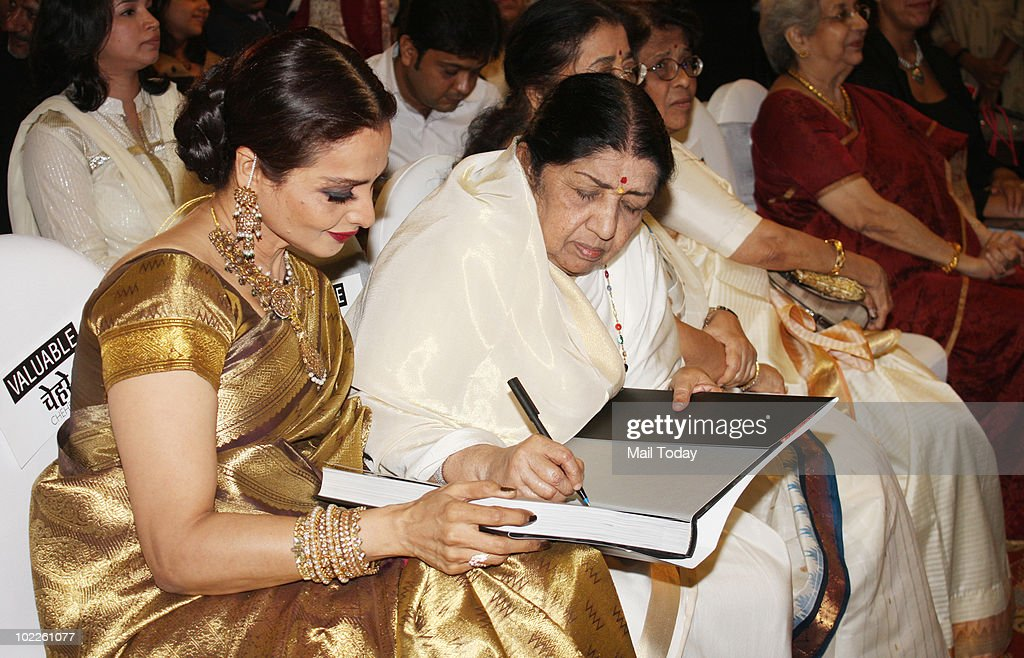 Rekha with Lata Mangeshkar at the launch of `Chehere` a coffee table book compiled by celebrity photographer Gautam Rajadhakshya in Mumbai on June 18.