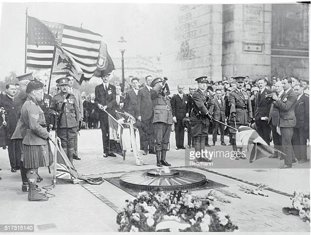 Rekindling the flame of international friendshipSergeant Andrews in kilts rekindles the scared flame at the tomb of the Unknown Soldier of France on...