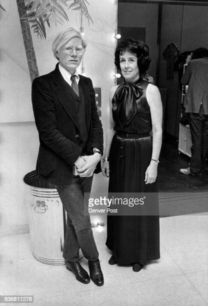 Reknowned artist Andy Warhol poses with Mrs Robert Yant during the opening night of the Warhol exhibit at the Denver Art Museum Credit Denver Post