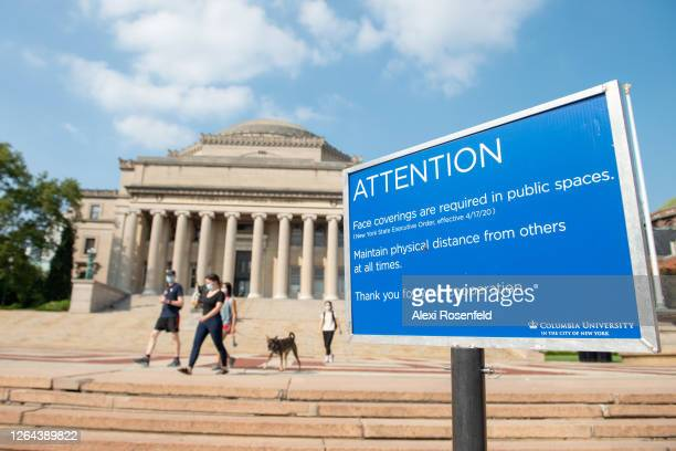 Related instructional 'attention' sign is seen on Columbia University's campus as the city continues Phase 4 of re-opening following restrictions...