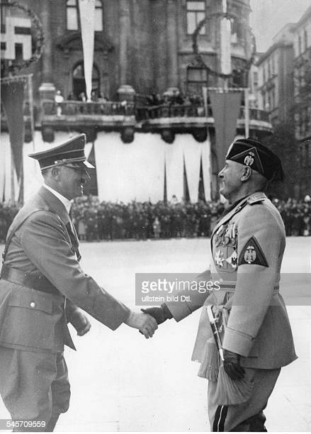 Relations Germany Italy Mussolini on a state visit to Germany Adolf Hitler welcoming Benito Mussolini Photographer PresseIllustrationen Heinrich...