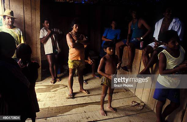 Relationship between Yanomami indigenous people and independent mine workers called garimpeiros who invaded the indigenous territory Warehouse in...