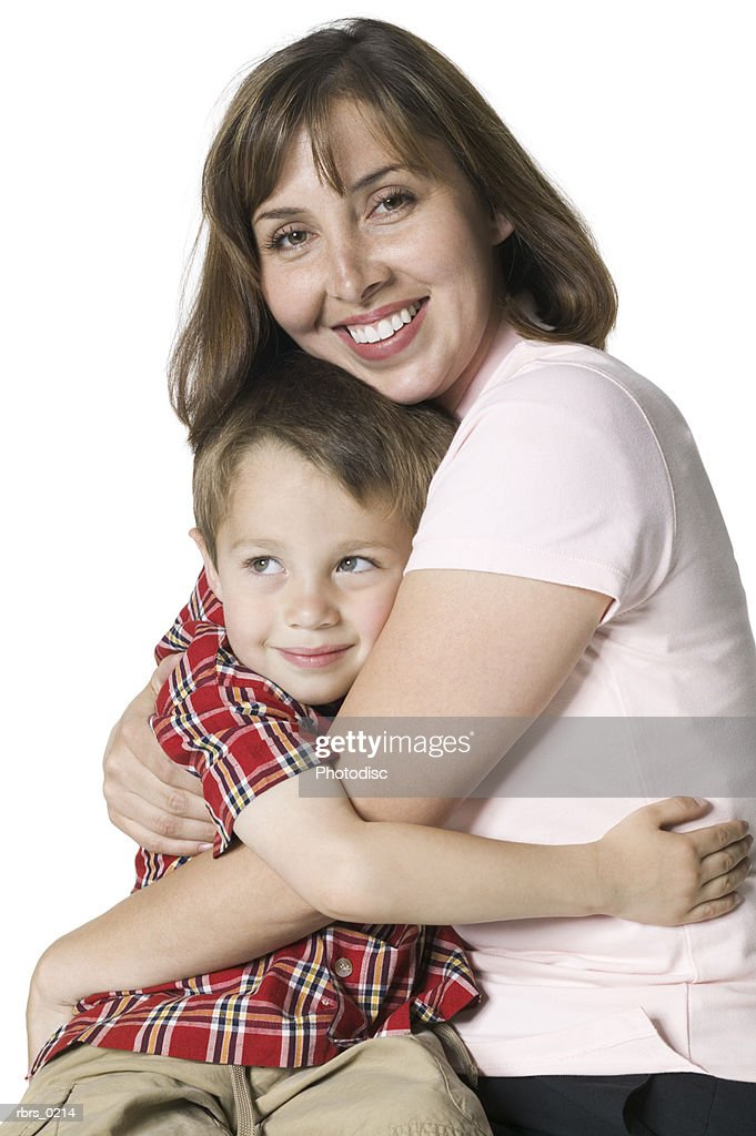 relationship portrait of a mother smiling and hugging her young son : ストックフォト