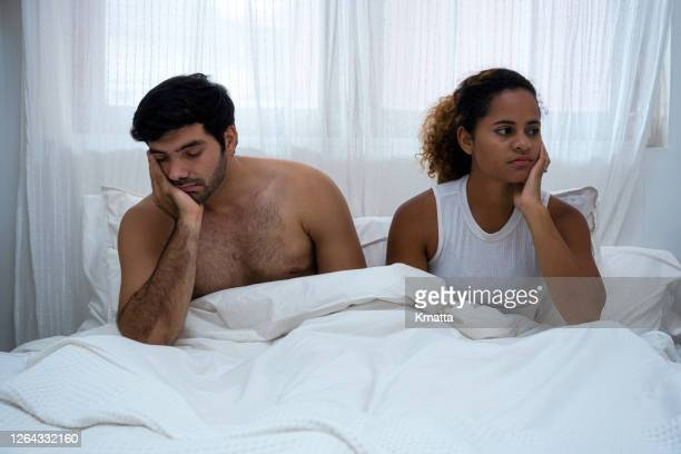 relationship problems - bed stock pictures, royalty-free photos & images
