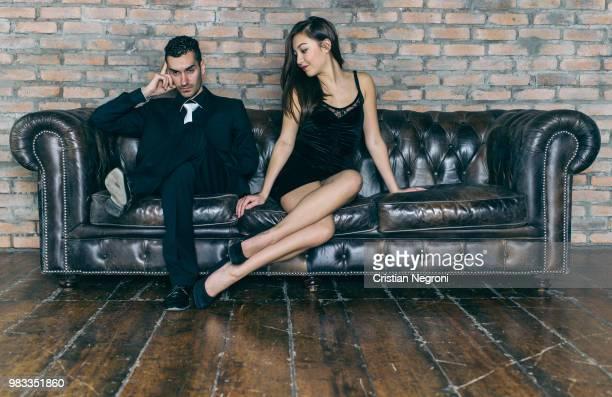 relationship problems. woman asking forgivness to her man - cristian neri foto e immagini stock