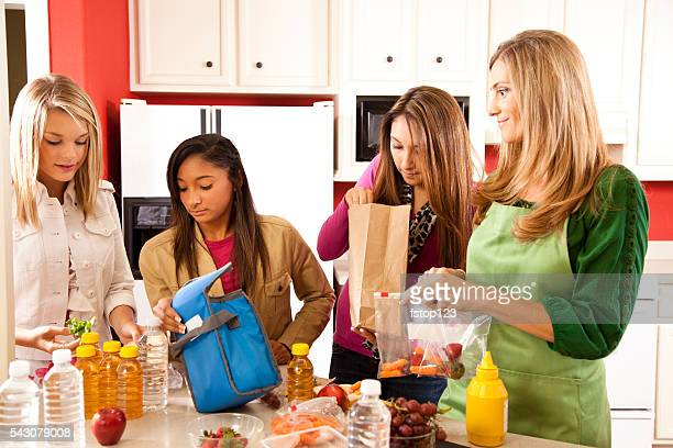 Relationships: Foster home teens, mom in kitchen making lunches.