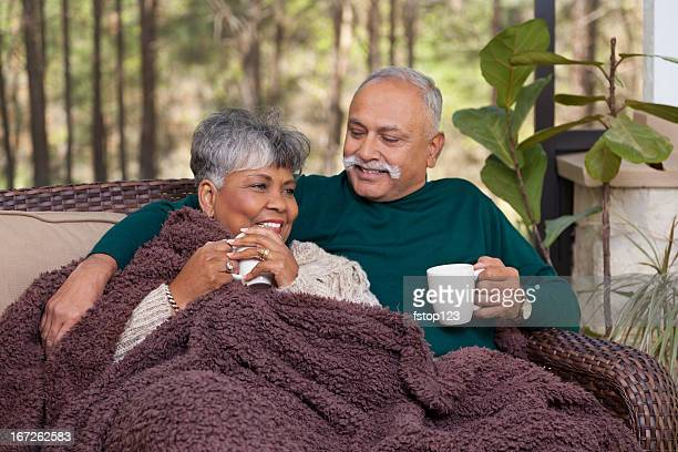 Relationships: Senior couple on screened porch enjoying conversation