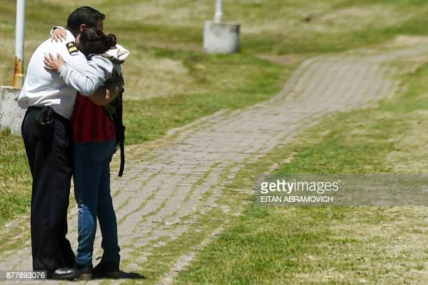 Relative and a comrade of one of the 44 crew members of Argentine missing submarine, embrace each other in grief at Argentina's Navy base in Mar del...