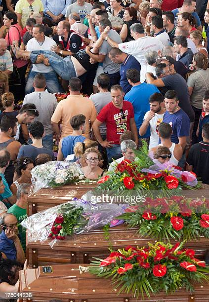 A relative breaks down after a mass funeral for the 38 people killed in Italy when a coach plunged off a viaduct near Naples on July 30 in...