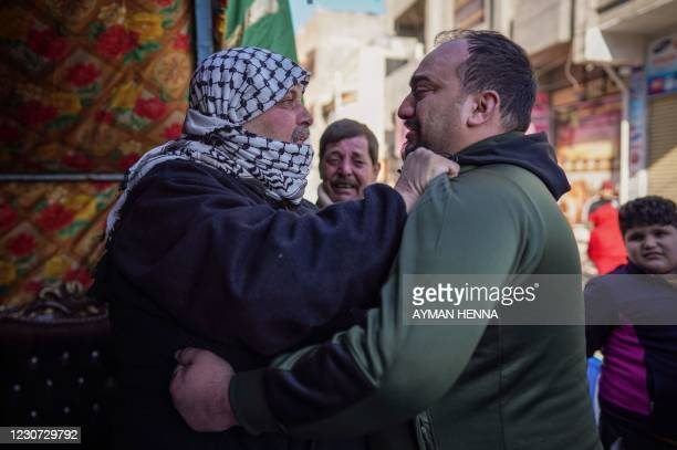 Relative consoles Louai al-Nuaimi , father of two Iraqi youngsters, Omar and Ali, killed in Baghdad's twin suicide attacks, during a condolences...