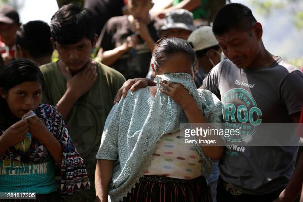 Relative cries during the burial of one of the victims of the landslide in the community of Quejá on November 09, 2020 in San Cristobal Verapaz, Alta...