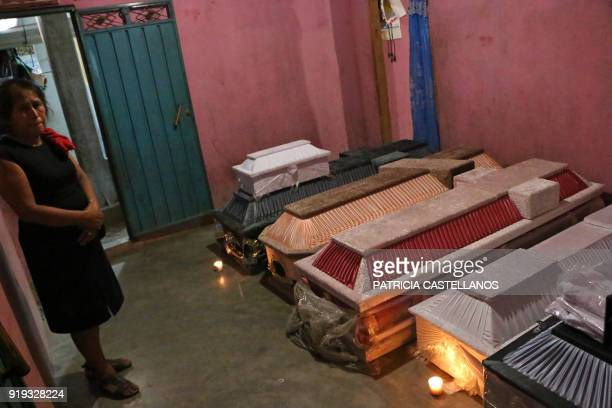 TOPSHOT A relative cries next to the victims's coffins after a military helicopter fell on vehicles in Santiago Jamiltepec Oaxaca state Mexico on...
