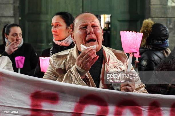 A relative cry during procession through the streets of Naples relatives and friends asking for the release of Raffaele Russo of his son Antonio 25...